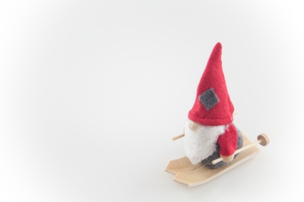 Santa Claus puppet on skis, wood wool